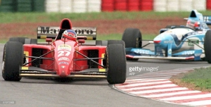 Jean Alesi is in front of Michael Schumacher